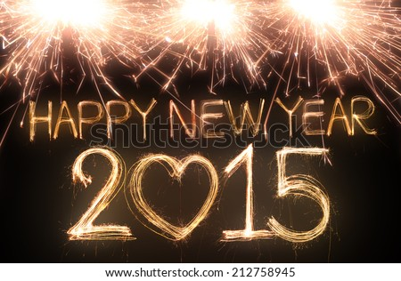 Happy new year 2015 written with Sparkle firework - stock photo