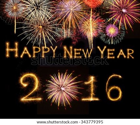 Happy new year 2016 written with Sparkle firework on black background with fireworks - stock photo
