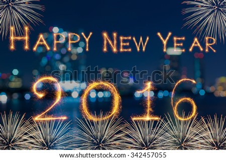 Happy new year 2016 written with Sparkle firework on photo blurred bokeh background
