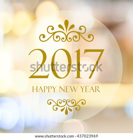 Happy New Year 2017 year on abstract blur festive bokeh background - stock photo