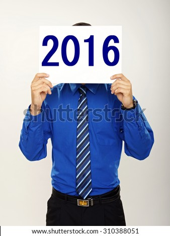Happy new 2016 year. Young businessman in blue shirt holding a sign in front of his head. - stock photo