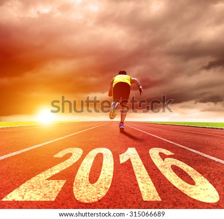 happy new year 2016. young man running with sunrise background   - stock photo