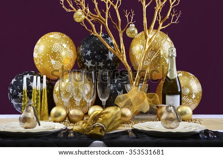 Happy New Years Eve elegant dinner table setting with black and gold decorations, balloons and stylish centerpiece.  - stock photo