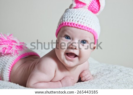 happy newborn baby dressed in Easter bunnies - stock photo