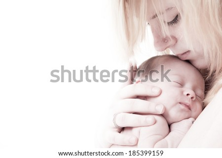 happy newborn baby girl just a week old photographed in the studio - stock photo