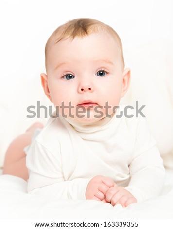 happy  newborn baby on a white background - stock photo
