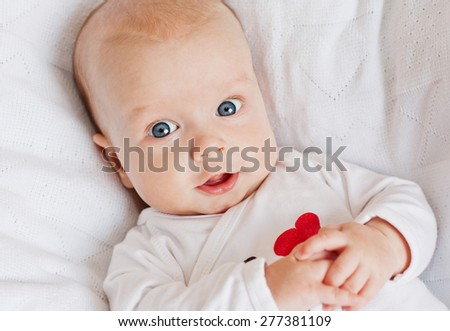 happy newborn baby smiling looking at the camera - stock photo