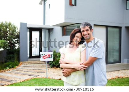 Happy newlyweds with their new house