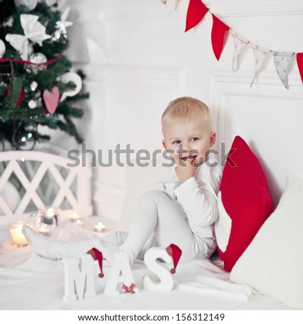 happy nice boy celebrating New Year at home - stock photo