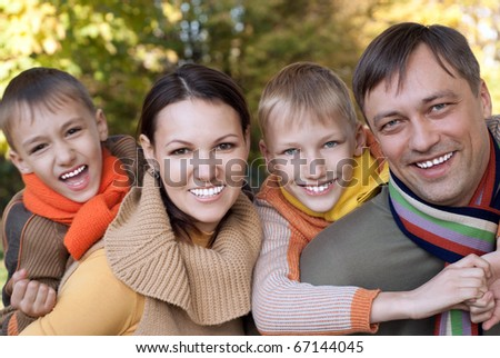 happy nice family of four on the nature