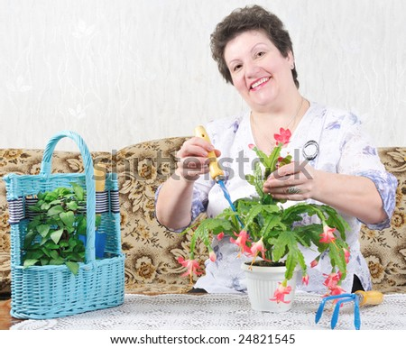 happy nice woman with flower - stock photo