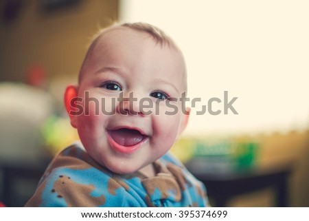 Happy nine month old baby boy - stock photo
