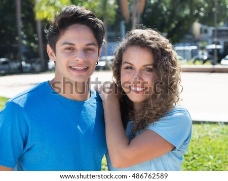 Happy north american couple looking at camera