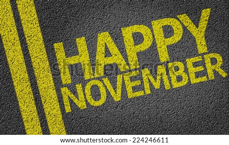Happy November written on the road - stock photo