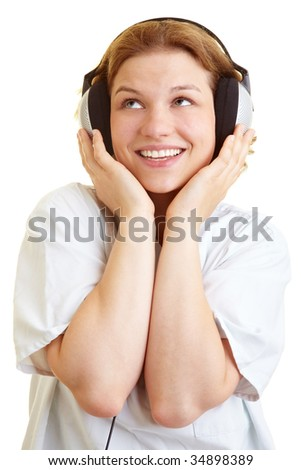 Happy nurse listening to music with headphones - stock photo