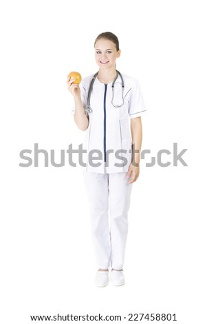 Happy nutritionist holding an orange