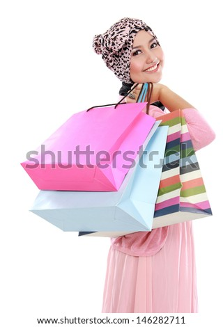 Happy of attractive young muslim woman with shopping bag isolated over white background - stock photo