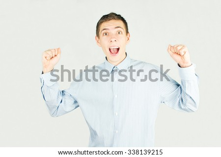 Happy office man say yes and very happy - stock photo