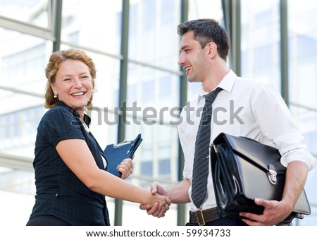 Happy office workers greet each other outdoor - stock photo