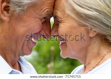 happy old couple in a summer park - stock photo