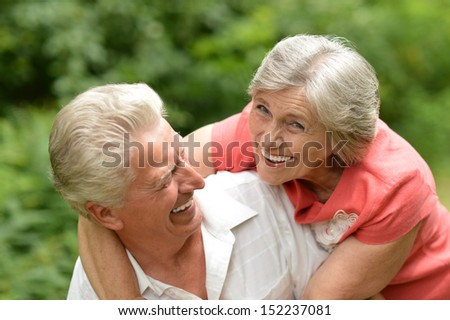 Happy old couple in the summer on a walk - stock photo