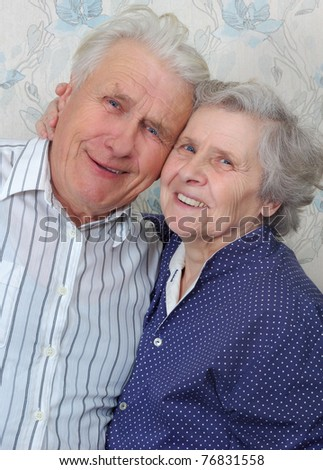happy old couple laugh until one cries - stock photo