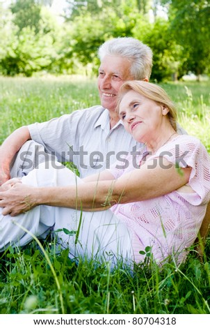 happy old couple playing at the nature