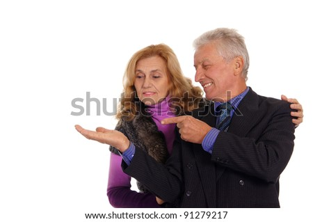 happy old couple posing on a white