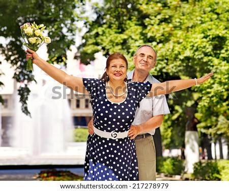 Happy old couple  summer outdoor. - stock photo