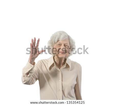 Happy old lady waving. Isolated with copy space. - stock photo