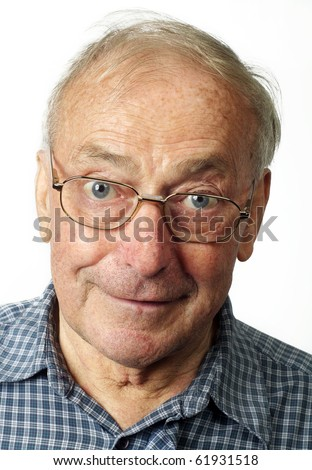 Happy old man smiling in closeup wearing glasses. Shot against white background. - stock photo