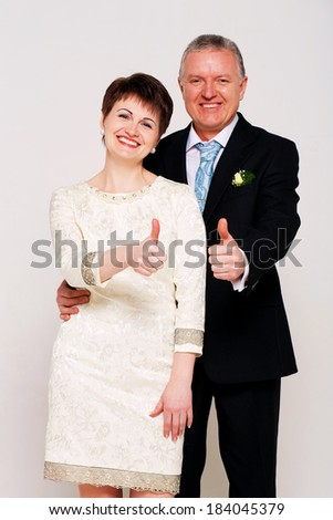 happy old married couple in studio - stock photo