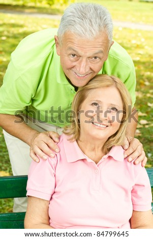 Happy old people relaxing outdoors. - stock photo
