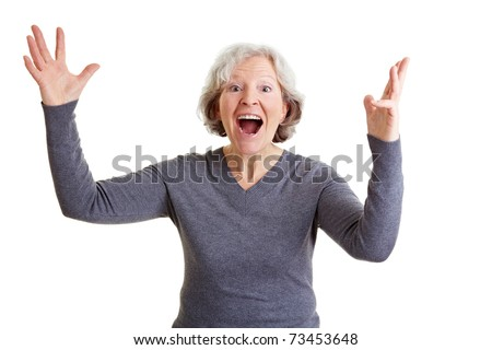 Happy old senior woman cheering with her hands in the air - stock photo