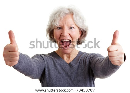 Happy old senior woman holding both thumbs up - stock photo