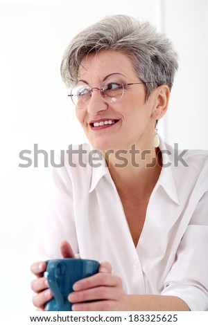 Happy old woman with tea cup