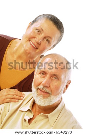 Happy older couple in their retirement age; isolated on white