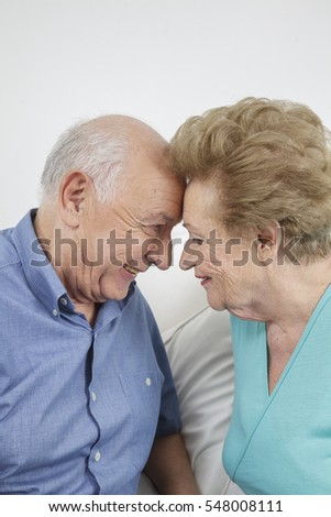 Happy older couple still in love and playing and being silly