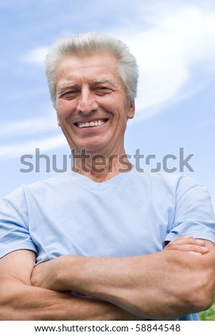 happy older man stands on the sky - stock photo