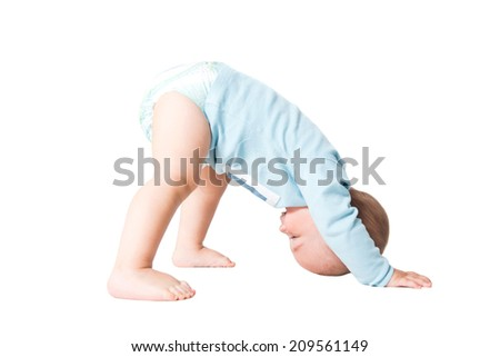 happy one year kid plying and having fun, isolated over white background  - stock photo