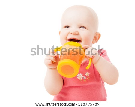 happy one year old baby drinking juice, isolated against white background
