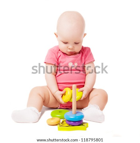 happy one year old baby playing with a pyramid, isolated against white background - stock photo