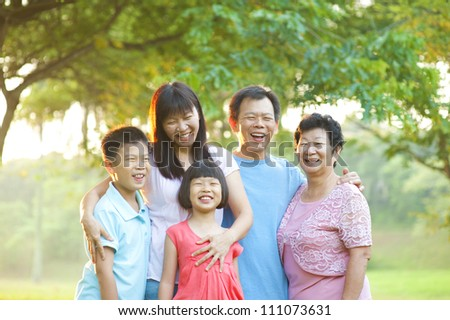 Happy outdoor family having great smile - stock photo