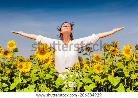 happy outstretced arms deep breathing outdoors - stock photo