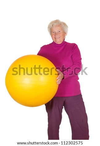 Happy overweight retired woman holding a yellow pilates or gym ball in her hands isolated on white - stock photo