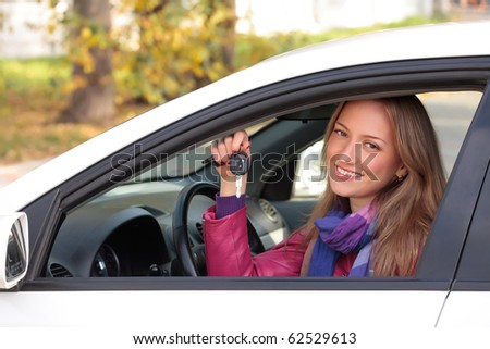 Happy owner of a new car. - stock photo