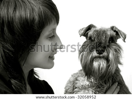 Happy owner with her pet schnauzer isolated on white - stock photo