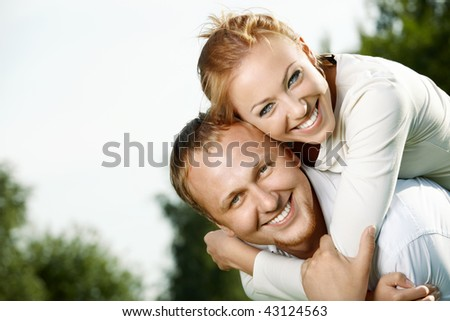 Happy pair has rest in a summer garden - stock photo