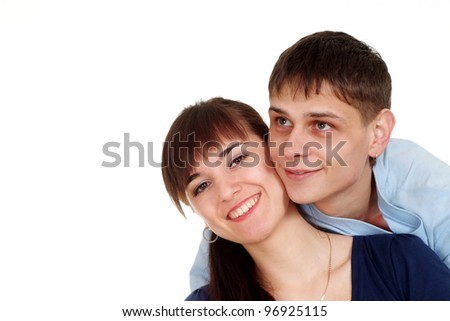 Happy pair in a blue shirt on a white background