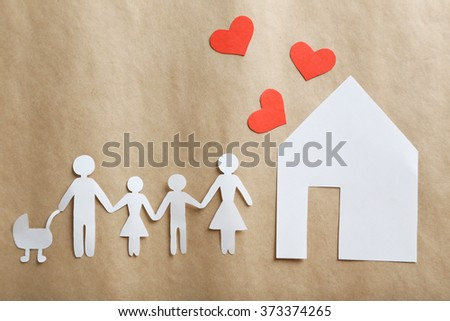 Happy paper family on paper background - stock photo